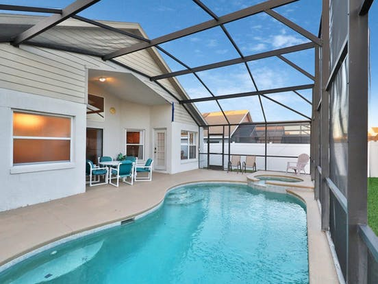 Enclosed outdoor pool and hot tub located in Orlando, FL