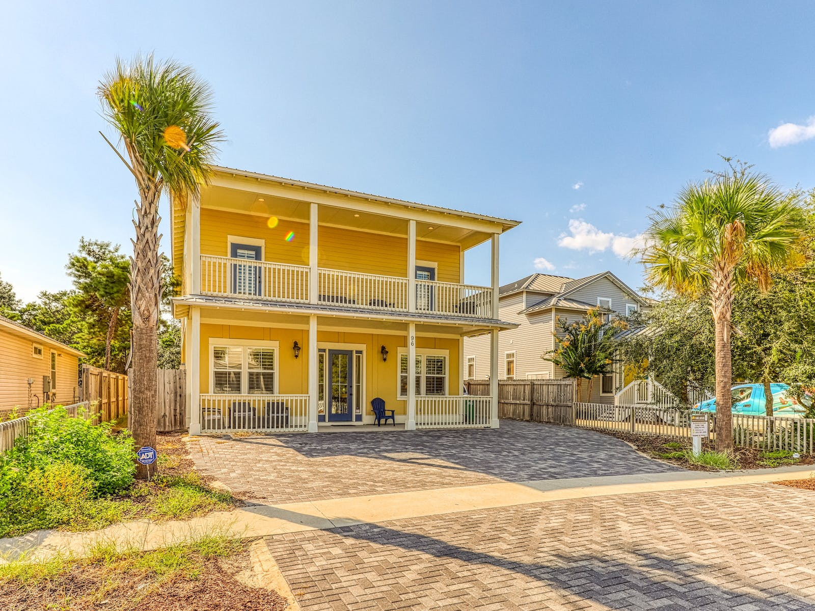 yellow exterior of florida vacation home