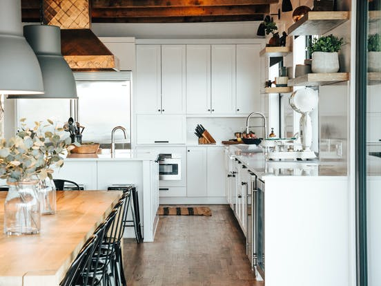 vacation rental kitchen on whidbey island with white cabinets and wood accents