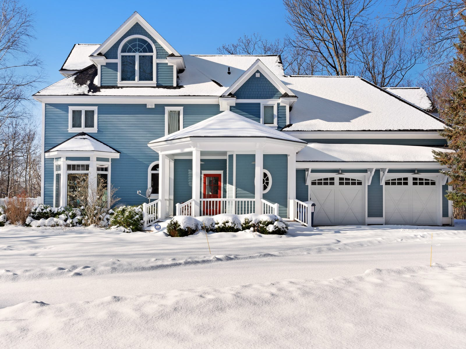 two-story home in harbor springs, mi covered in a fresh layer of snow