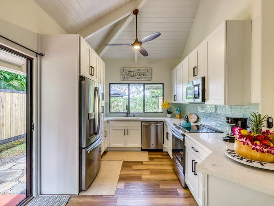 vacation rental kitchen with light blue backsplash in kauai, HI
