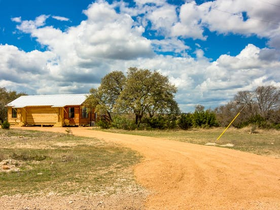 Vacation rental dirt driveway in Fredericksburg, TX