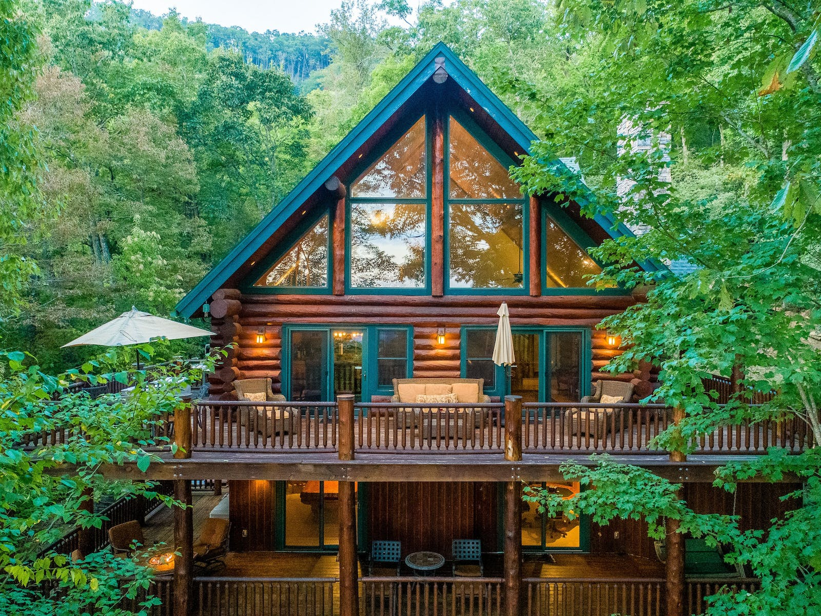 sylva, nc log cabin rental with two stories with wraparound decks and plenty of outdoor furniture