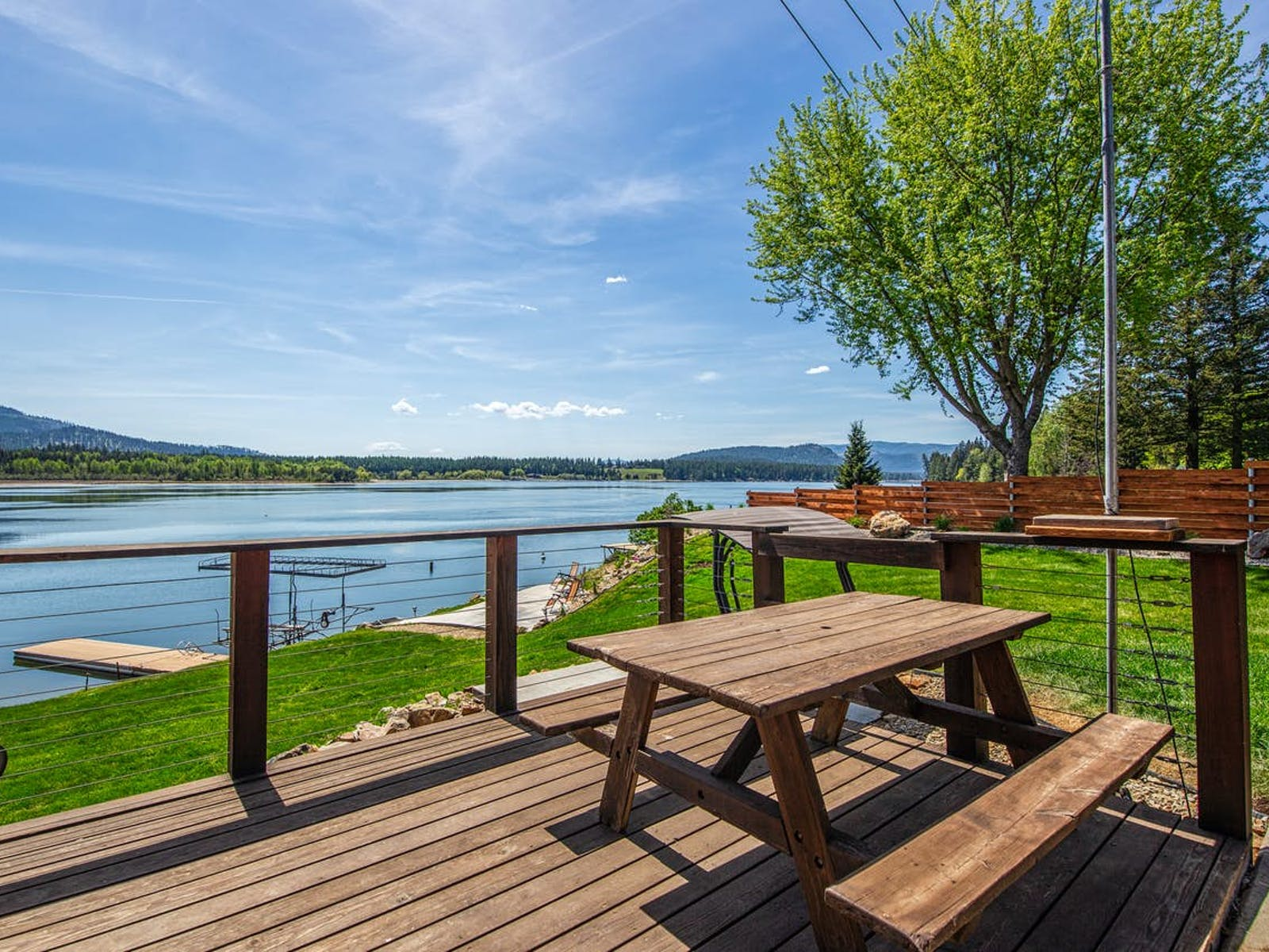 back deck of Riley Creek, ID vacation rental with picnic table and water views