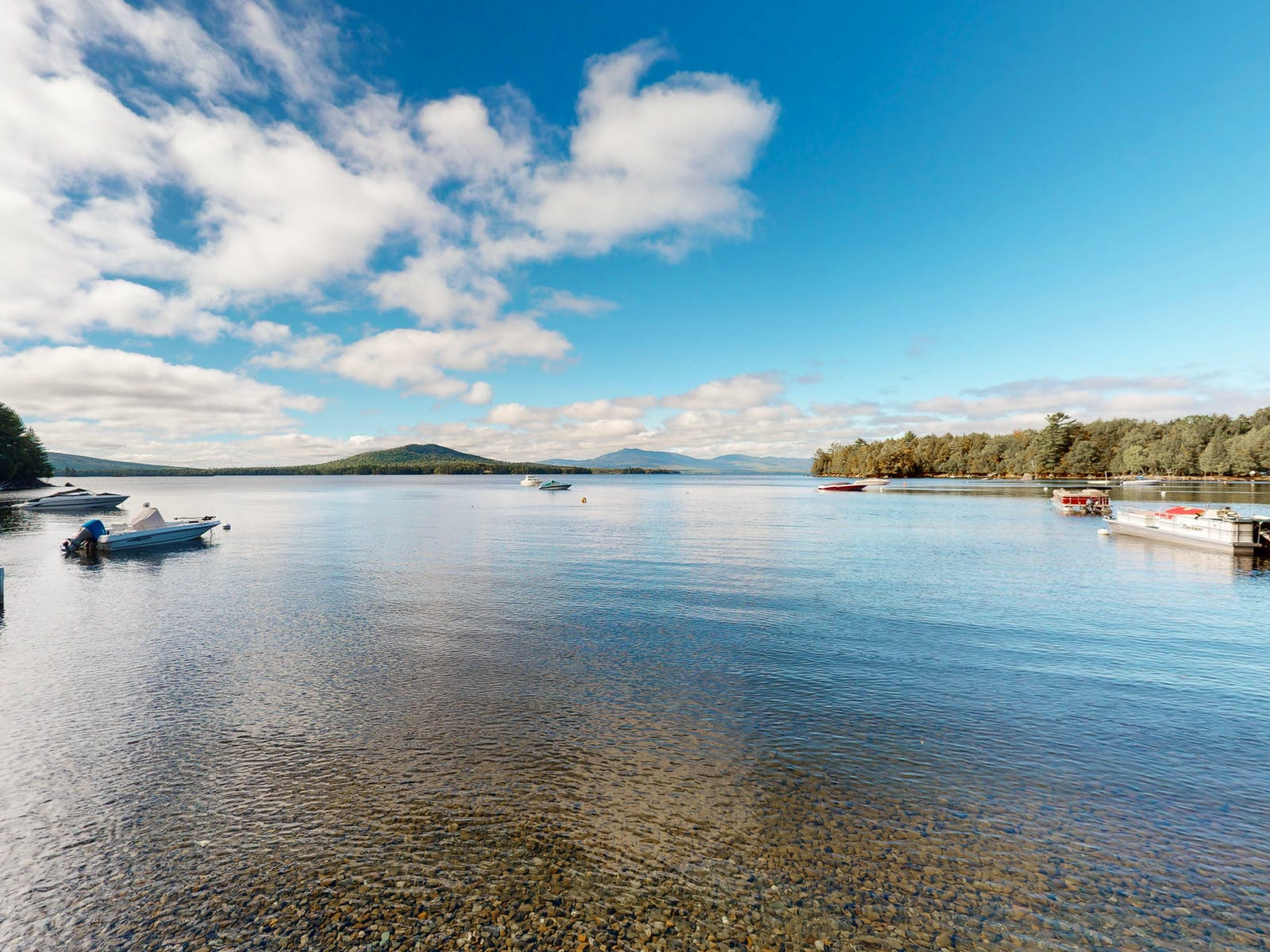 several boats sit in the lake waters of Beaver Cove, ME