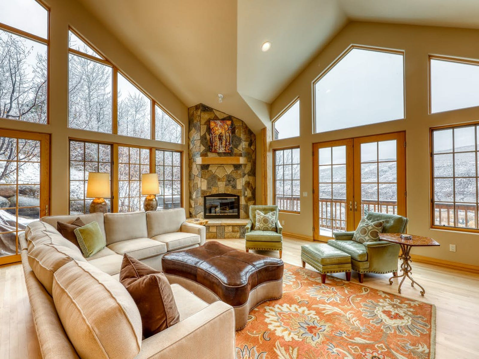 high ceilings and stone fireplace of vail, co vacation home