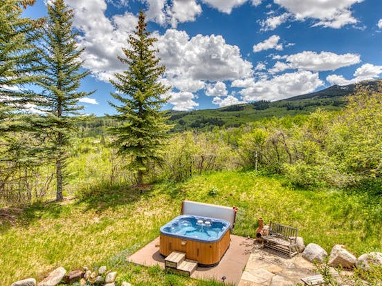 Outdoor hot tub of cabin in Snowmass Village, CO
