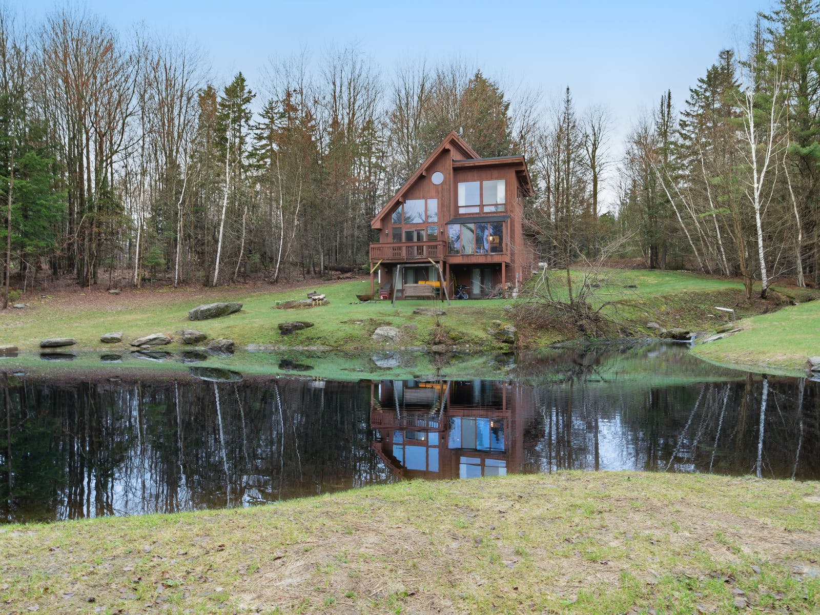 Vacation rental in Stowe, VT surrounded by woods and pond