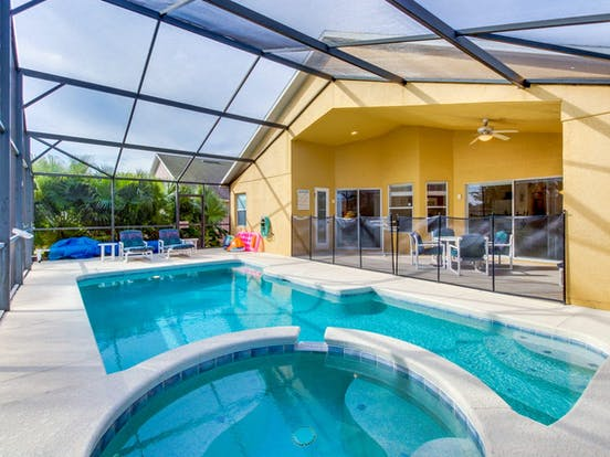 Enclosed pool with patio furniture in Davenport, FL