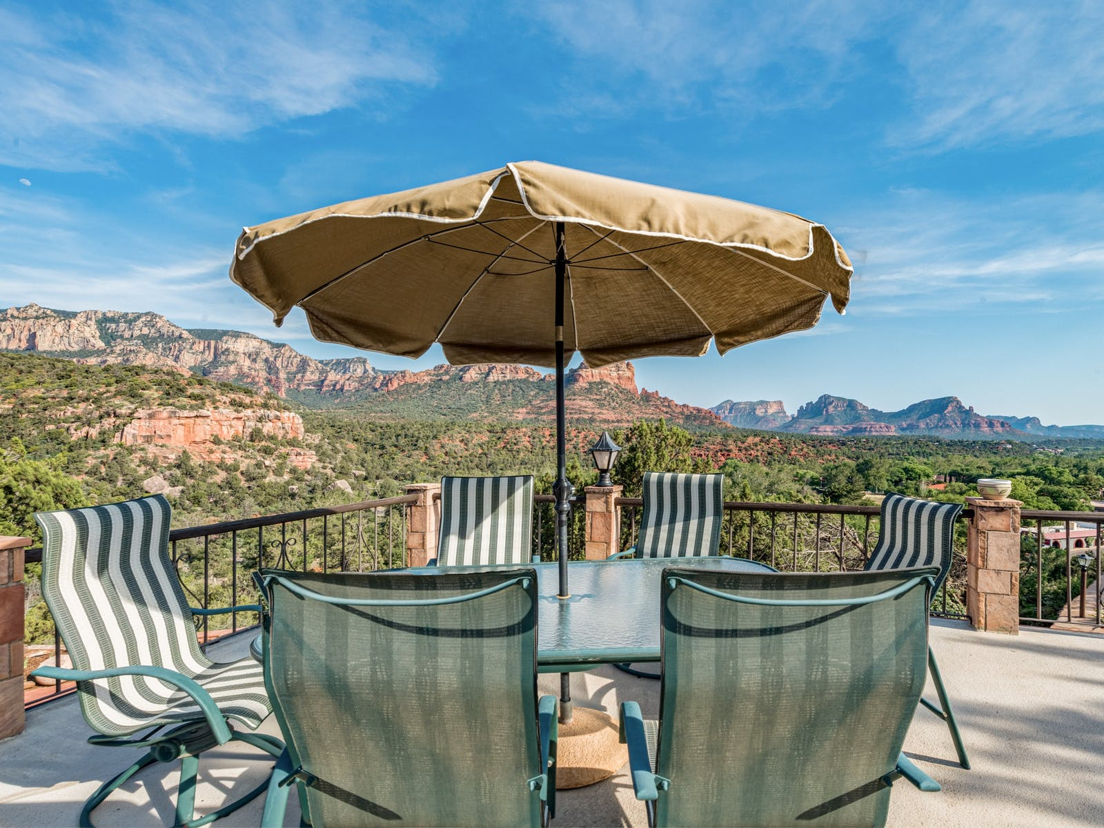 Sedona vacation rental patio with outdoor table and chairs and red rock views.