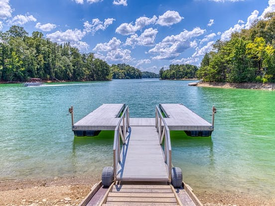 dock over beautiful blue-green water in sevierville, tn