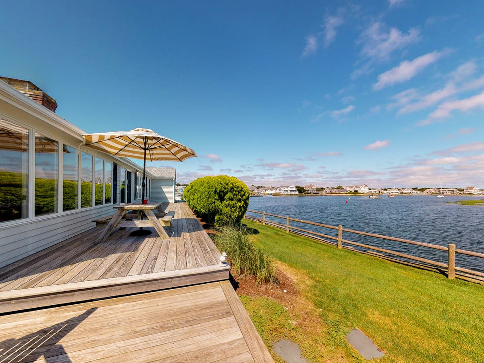 Cape Cod waterfront vacation rental back deck with view of the water