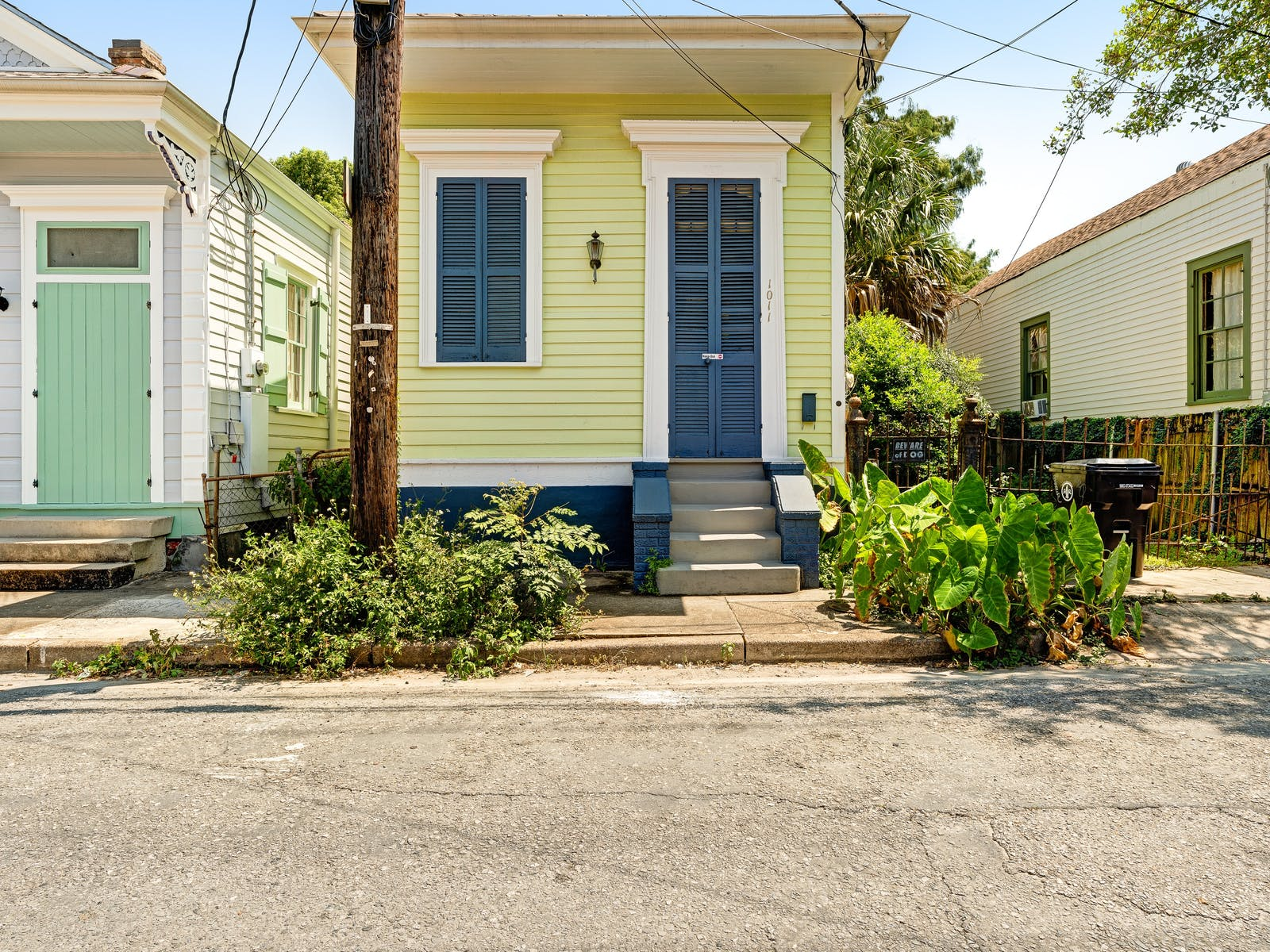 Adorable yellow vacation home in a neighborhood in New Orleans, LA.