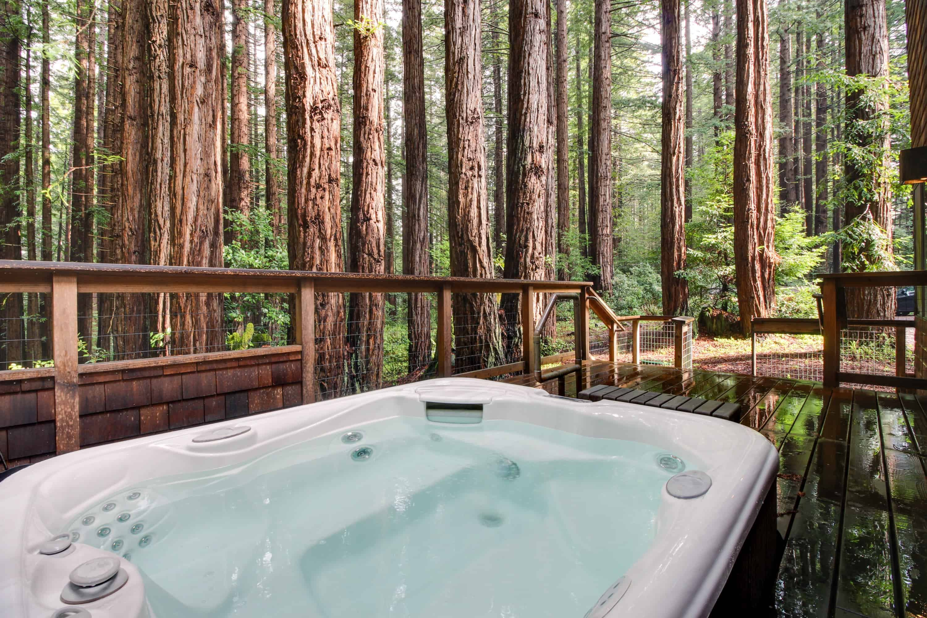 a hot tub overlooking the forest