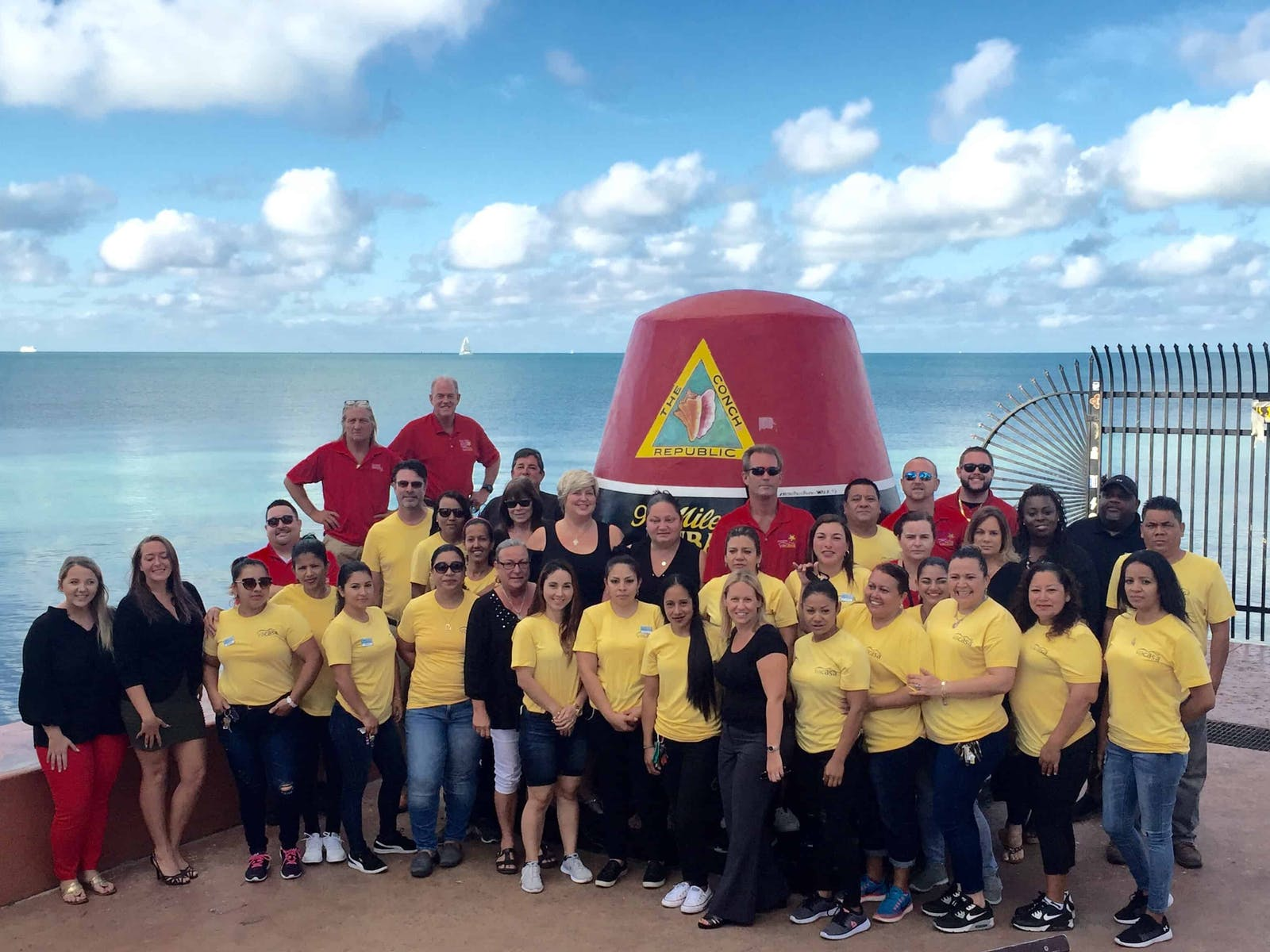 The Vacasa team taking a group photo in Key West, FL