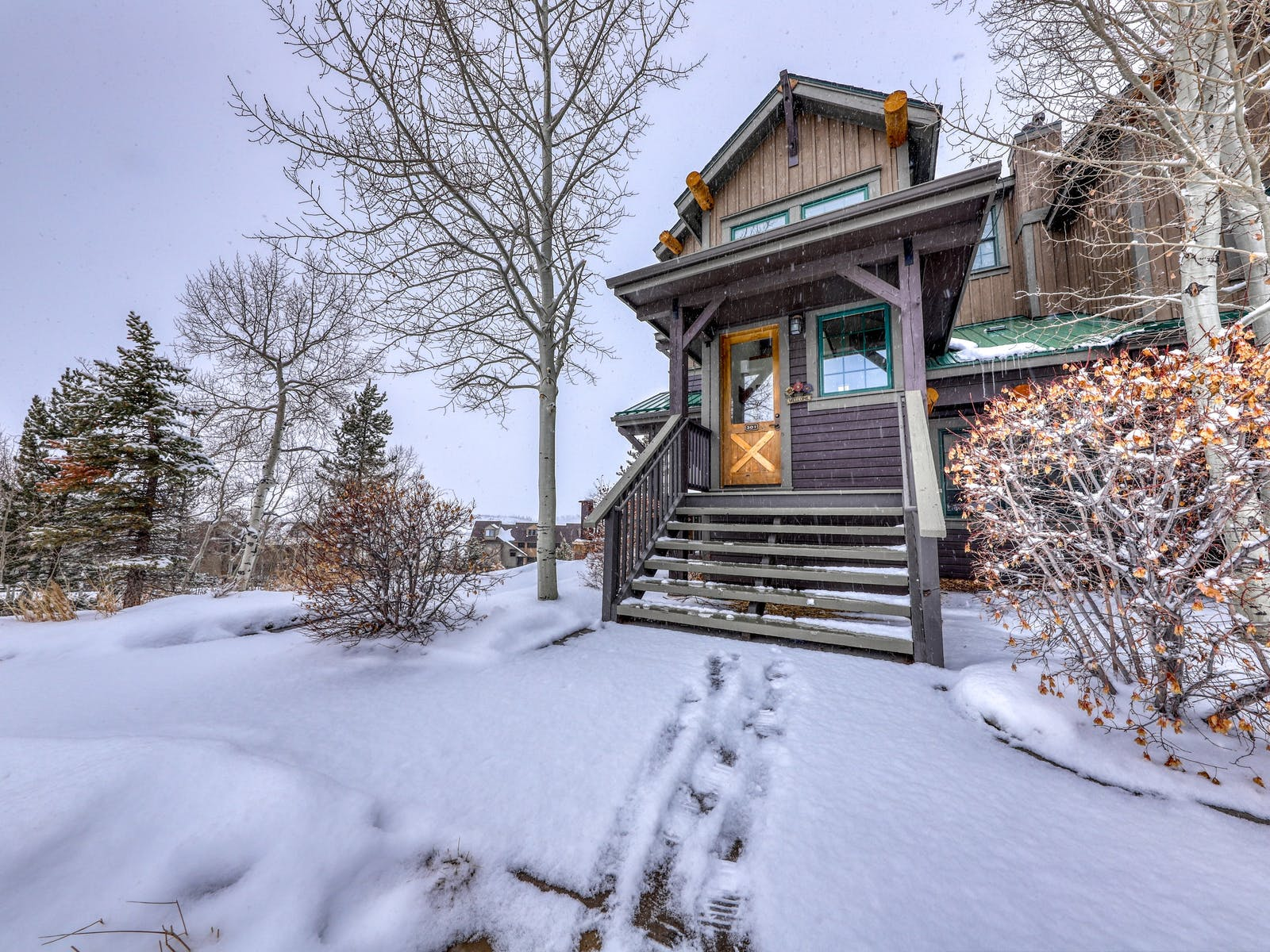 adorable cabin covered in snow in Granby, CO
