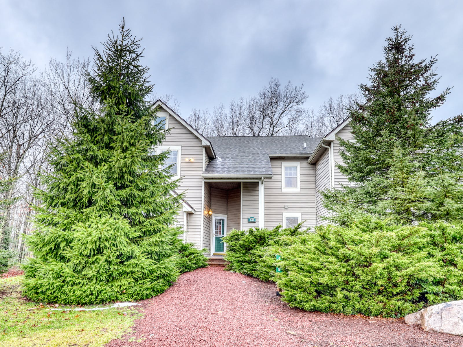 Tannersville, PA vacation home surrounded by tall pine trees