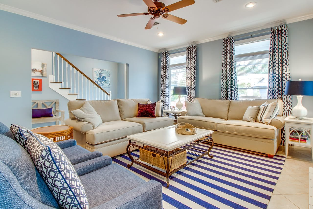 Living room of vacation rental decorated in blue hues located in Florida