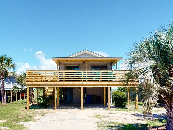 folly beach, sc beach house with two stories and wraparound deck