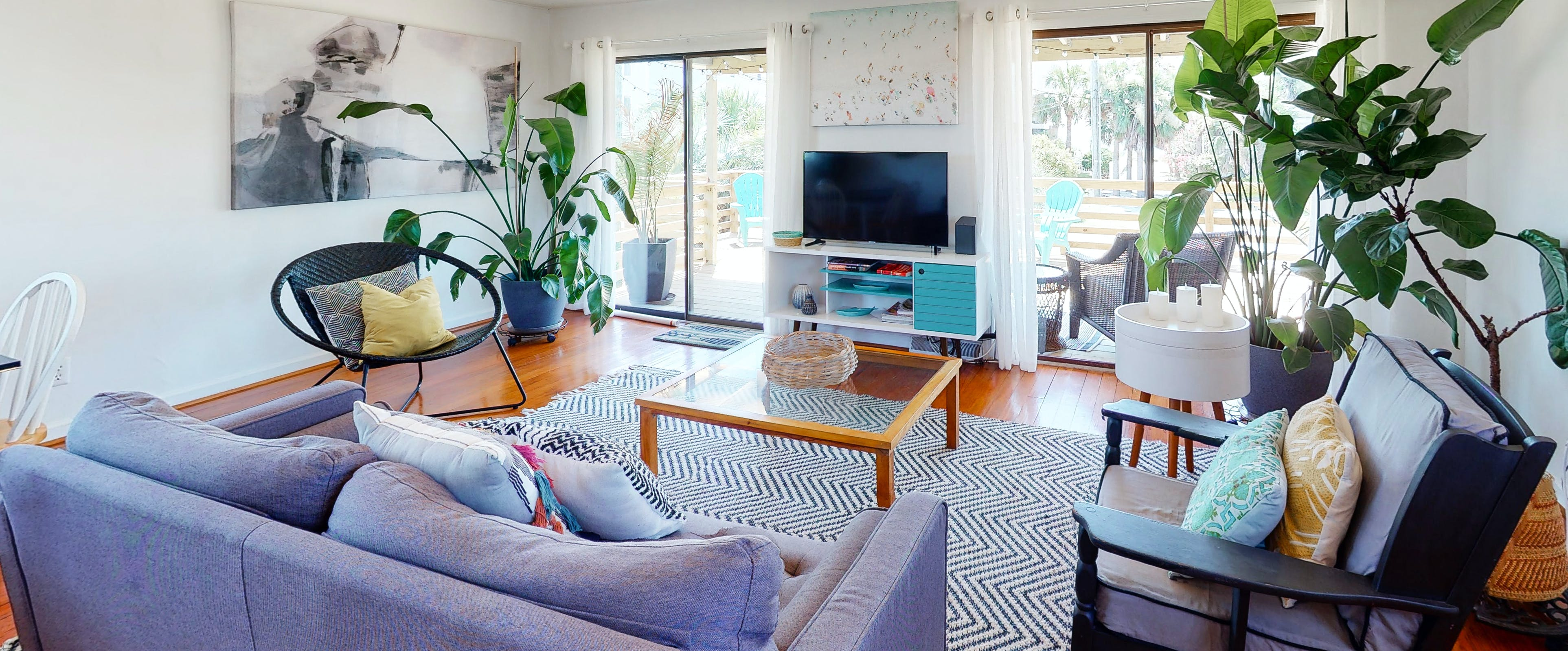 living room of folly beach vacation rental with large live plants