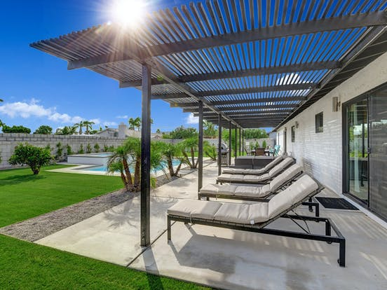 palm springs vacation rental with outdoor pool and large patio with lounge chairs