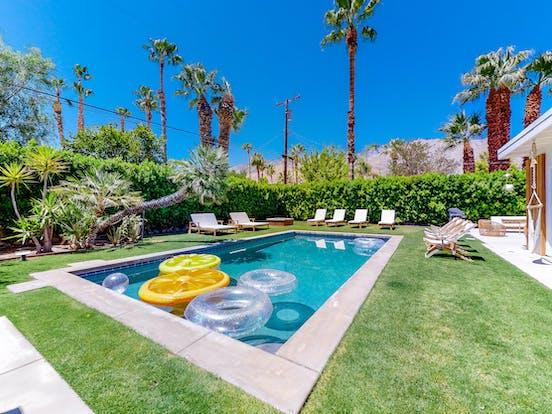lovely private pool with inner tubes and lounge chairs of palm springs, ca vacation home