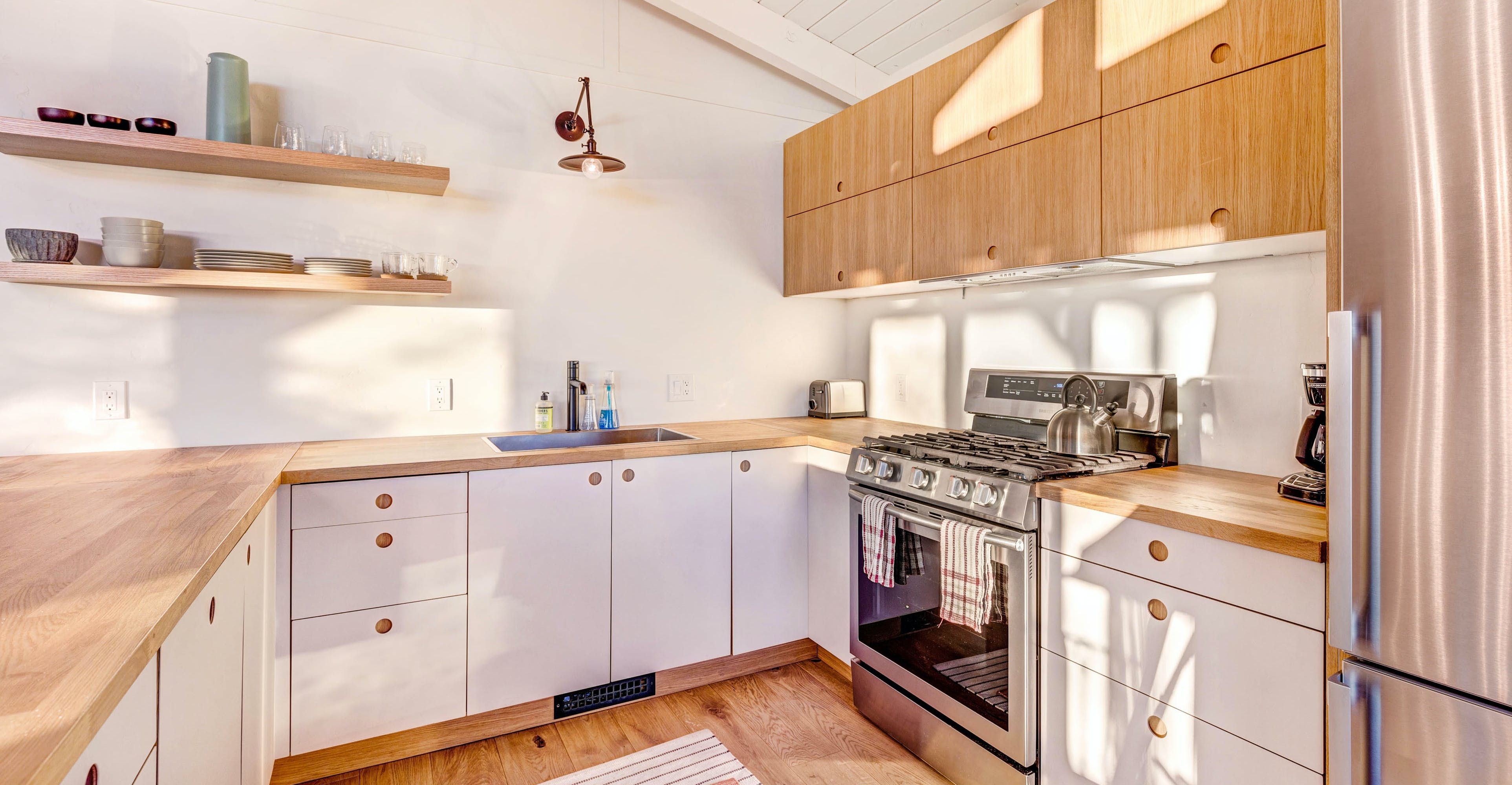 butcher block counters cover white cabinets in idyllwild, ca vacation home kitchen