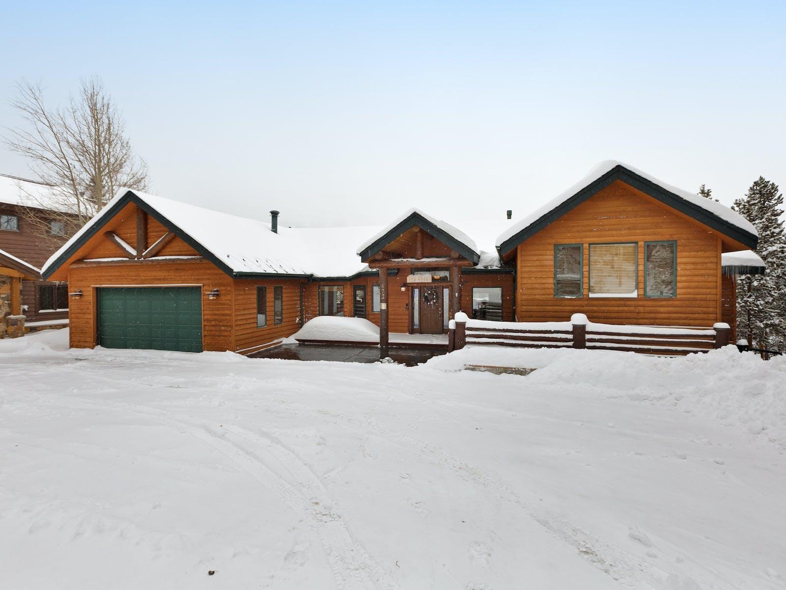 vacation cabin with green garage door in breckenridge, co