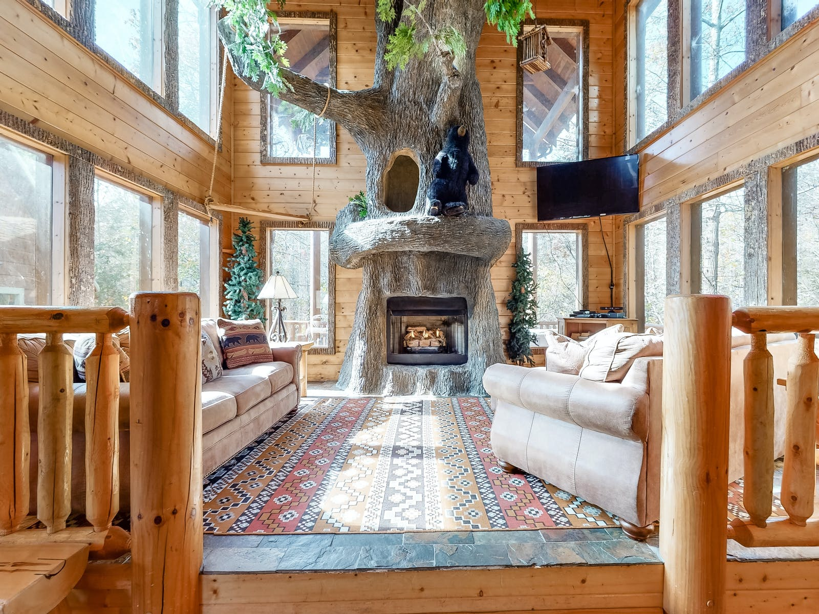 sevierville vacation rental with tree-shaped hearth with a swing