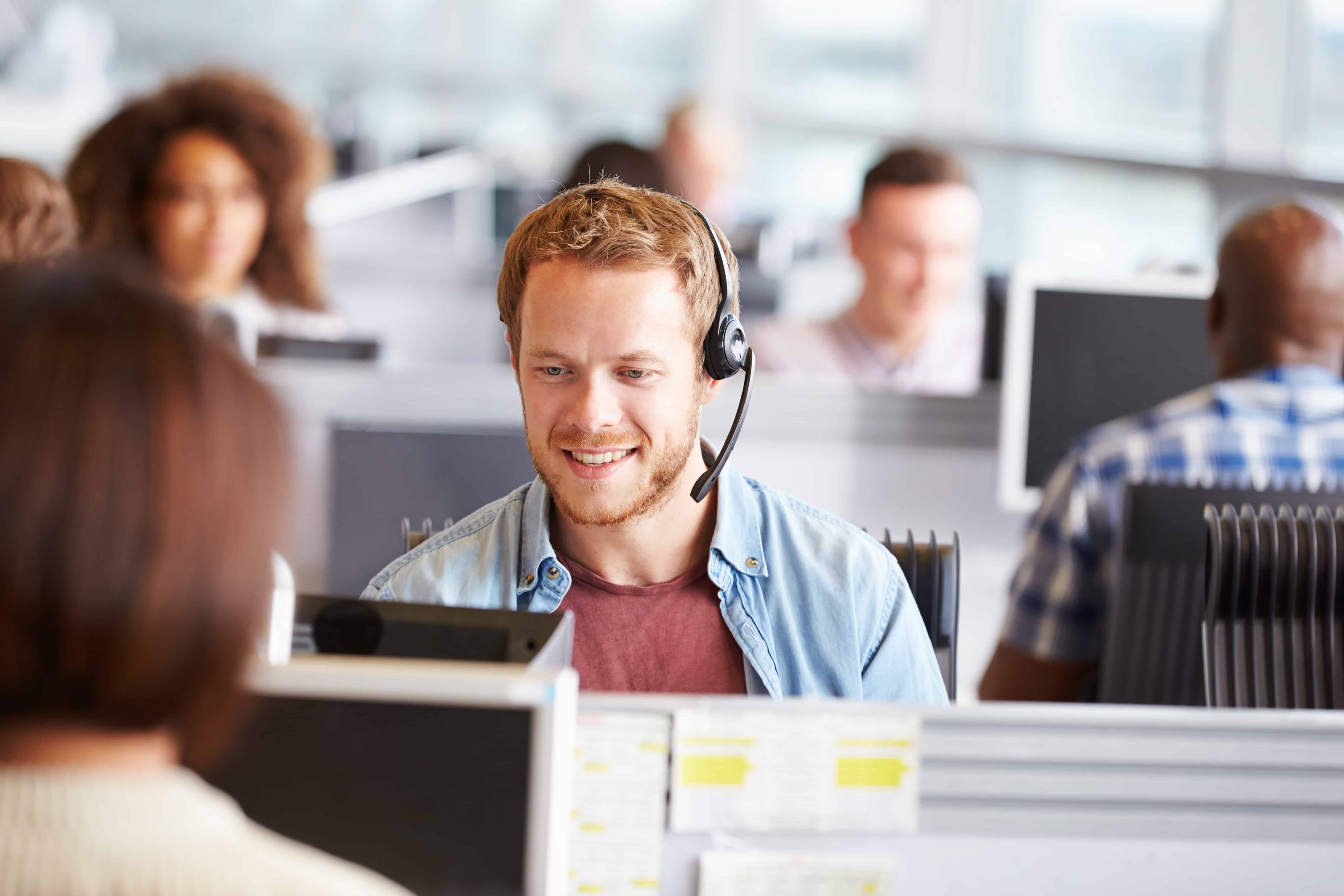 a support agent on the phone with a customer