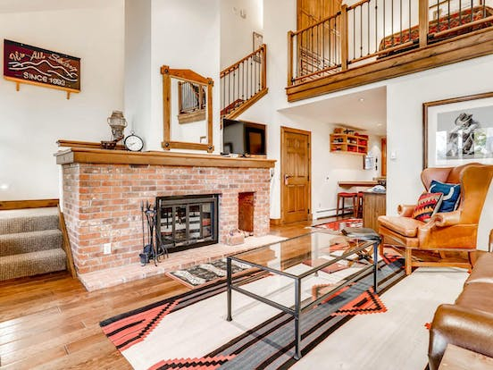 brick fireplace inside of Snowmass Village, CO vacation home