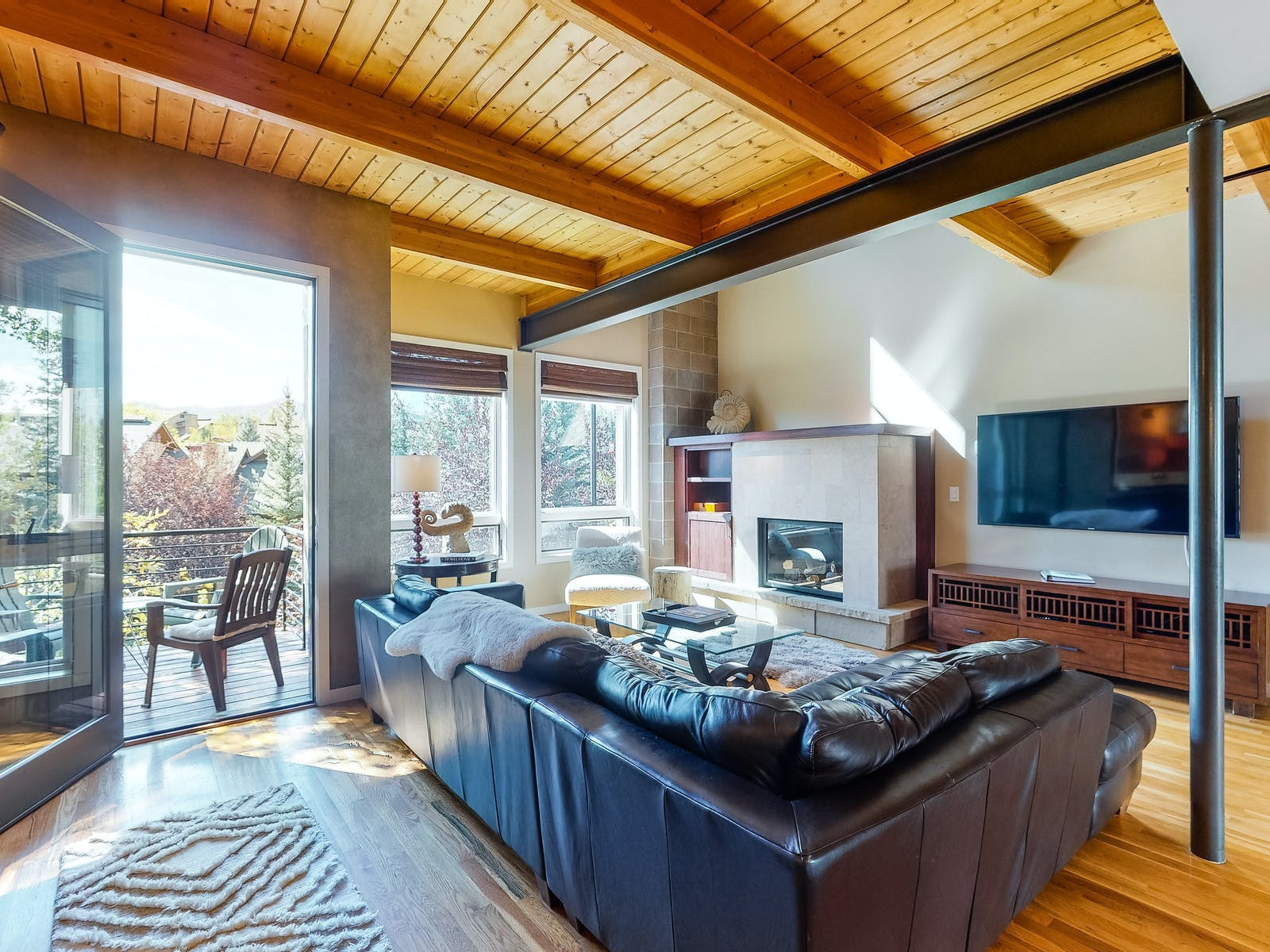 leather couch and wood paneling of steamboat springs, co vacation rental