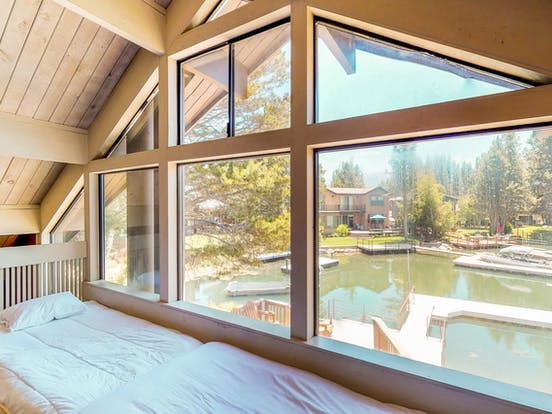 Waterfront vacation rental bedroom with views of the marina