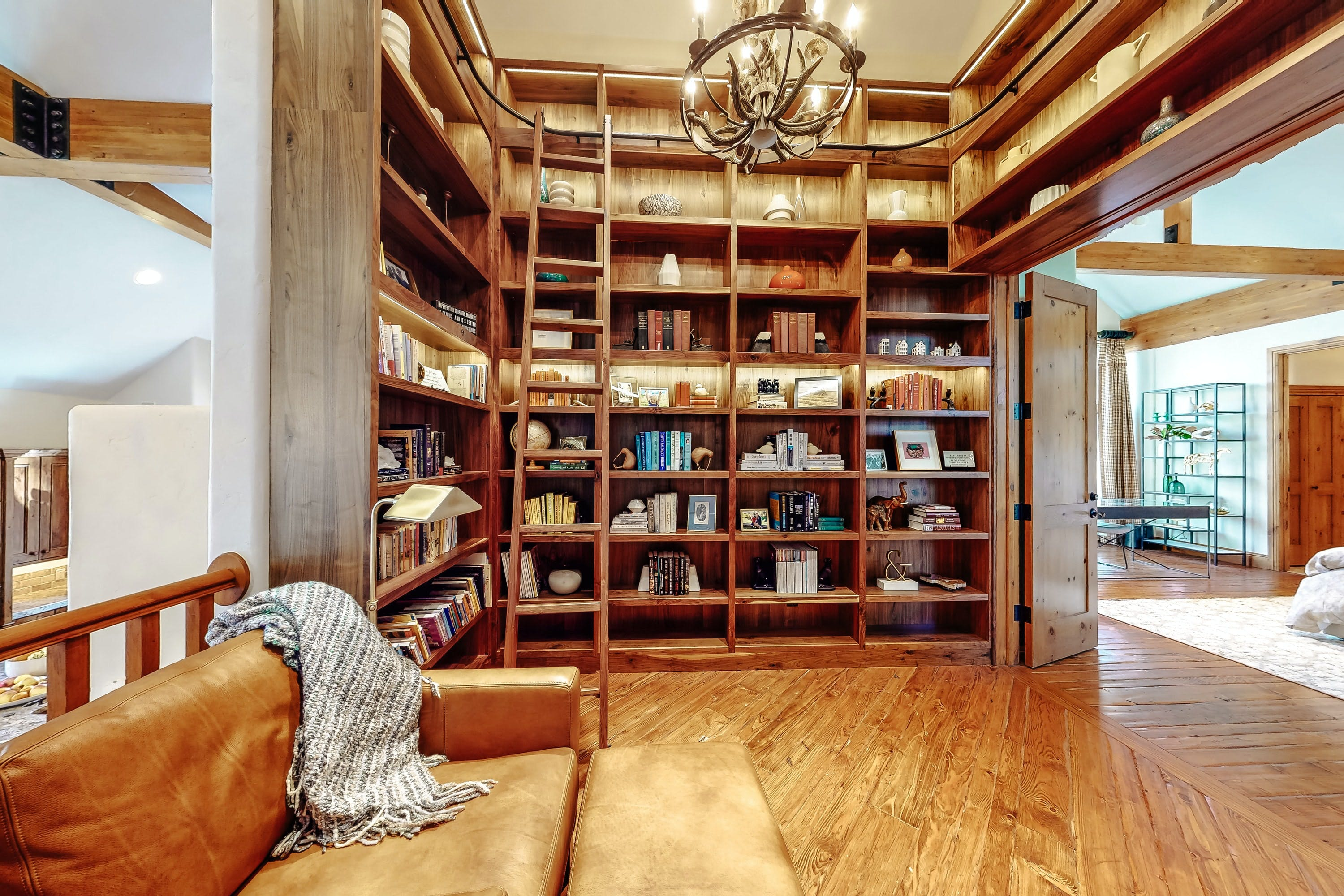 cozy reading nook and large library of Vail vacation rental