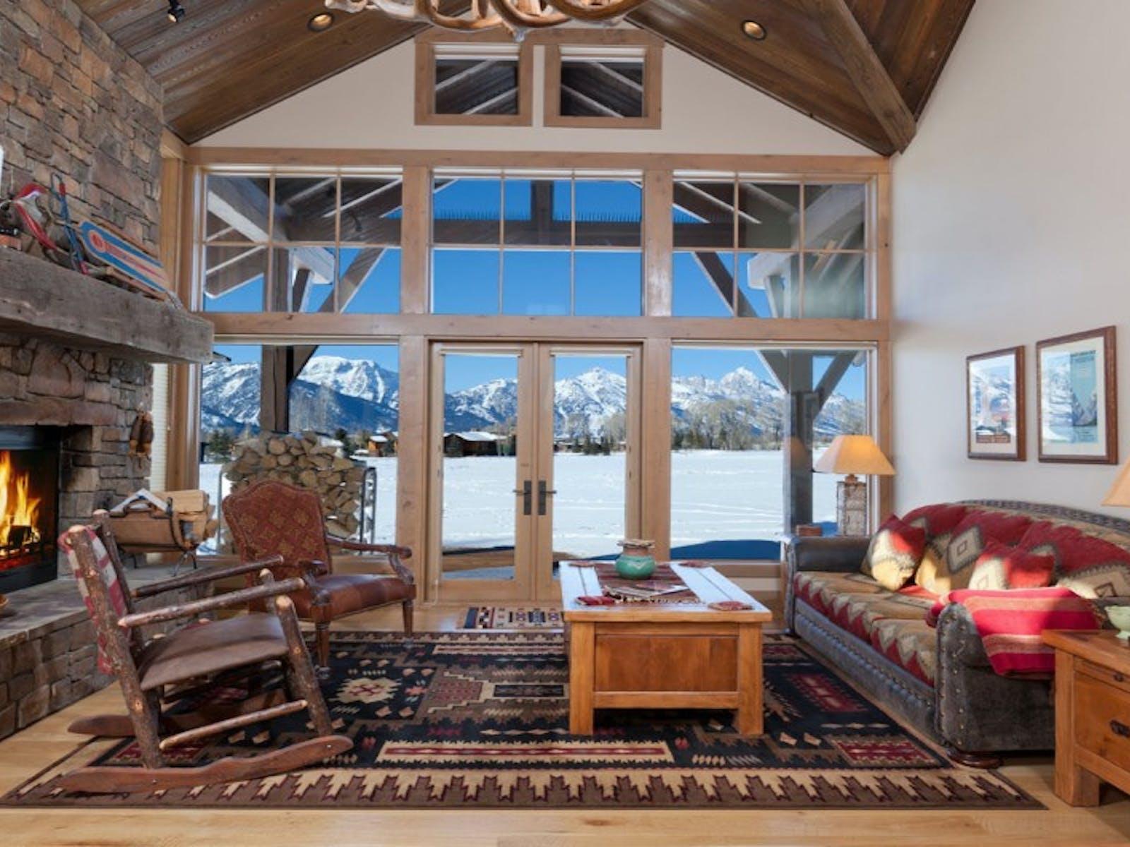 stone fireplace and cozy decor inside jackson hole, wy cabin