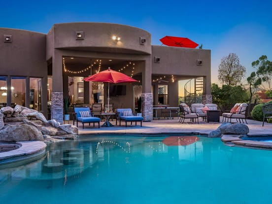 scottsdale vacation home desert oasis including infinity pool, hot tub, rooftop deck and fireplace