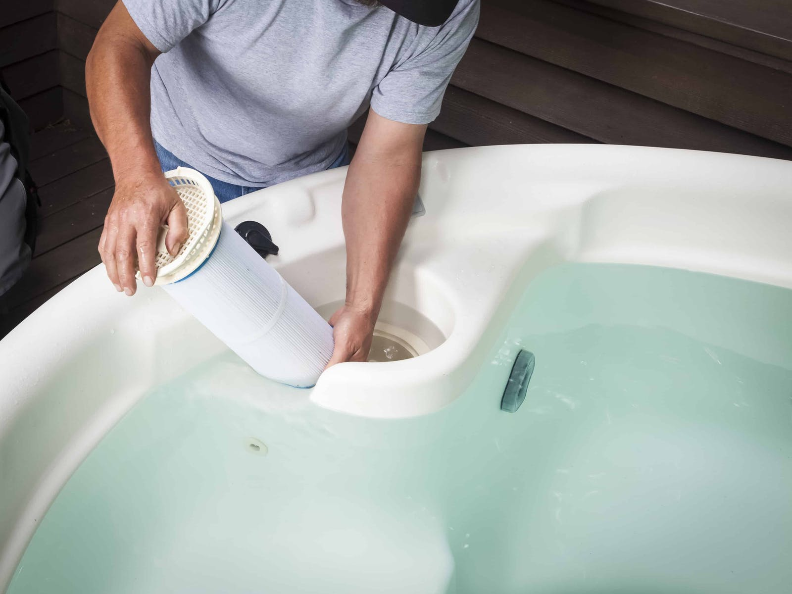 A housekeeper cleaning a hot tub