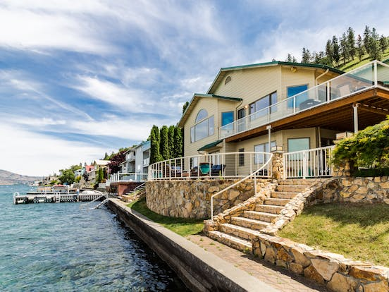 waterfront vacation rental with steps leading down to the water's edge on lake chelan