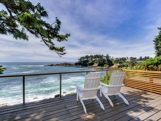 vacation rental with deck overlooking the beach