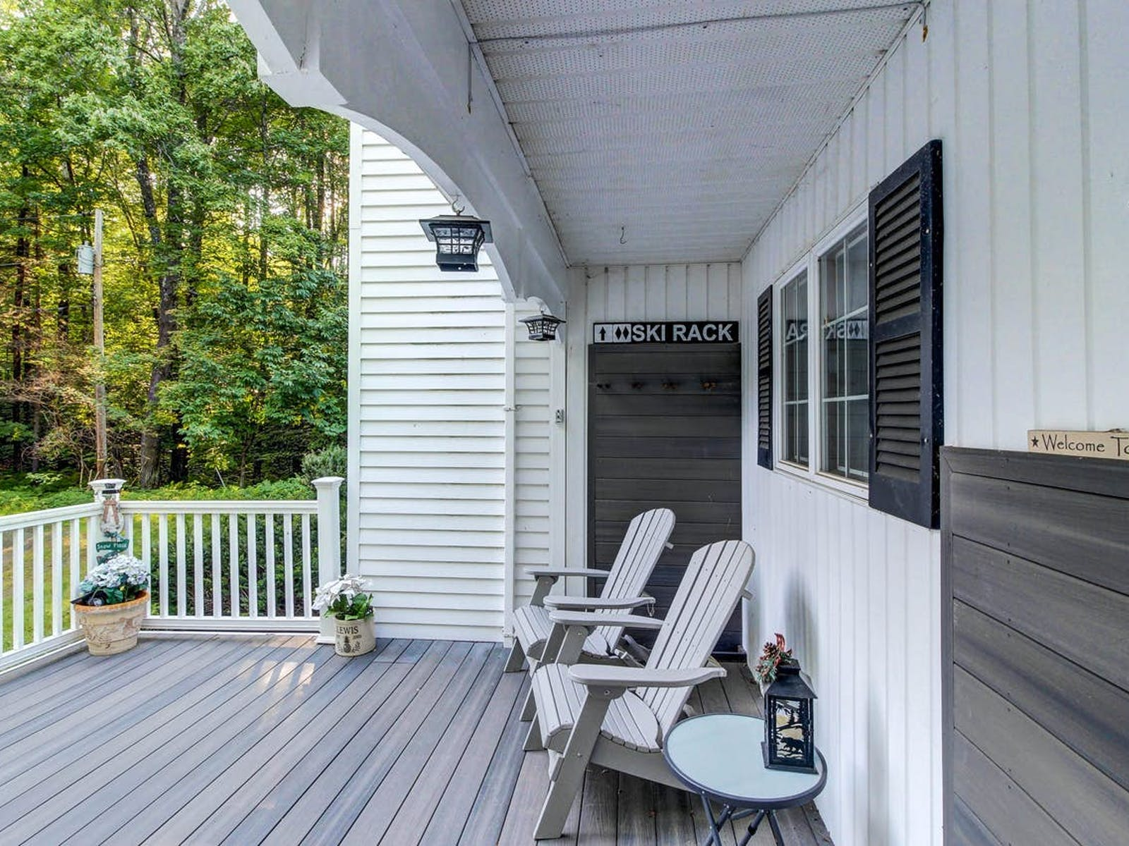 Killington, VT vacation rental with two adirondack chairs on the deck