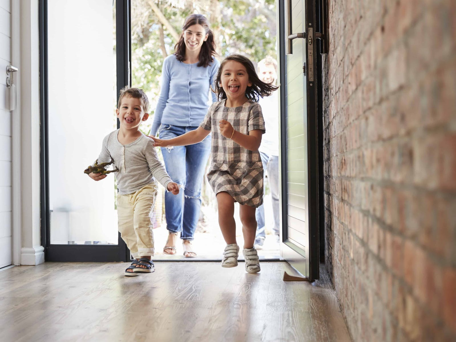 kids running through the front door of their family's vacation home.