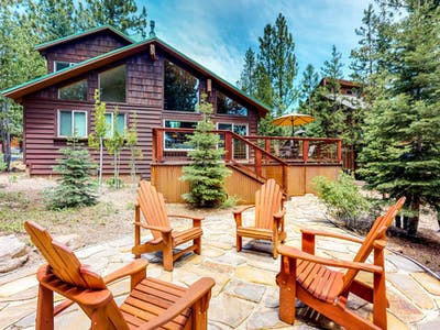 adirondack chairs placed around an outdoor patio