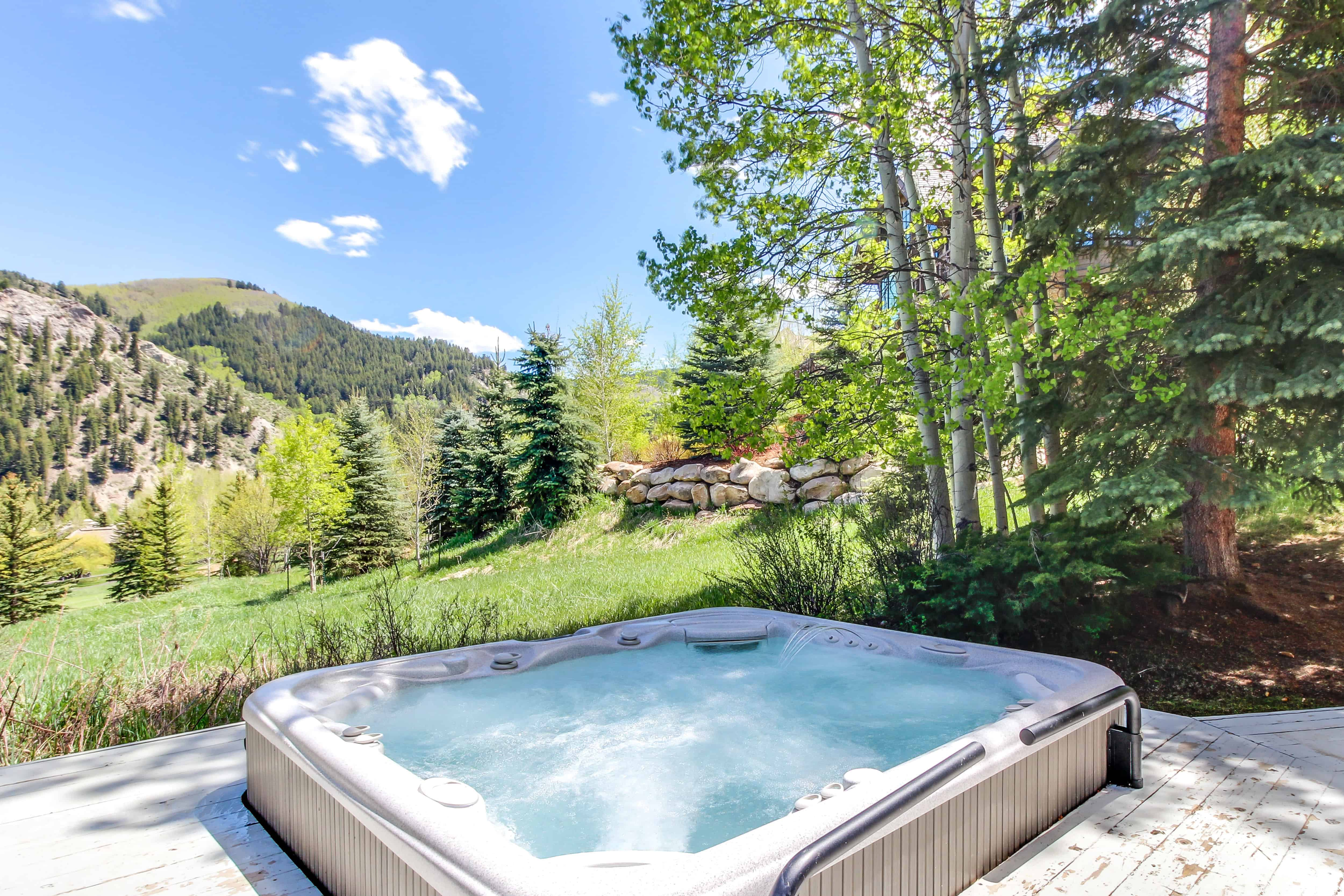 a hot tub on a patio in the mountains