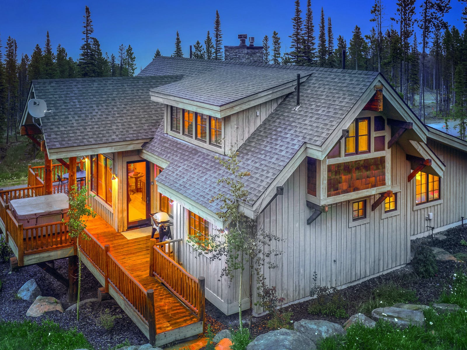 large cabin rental in Big Sky, MT lit up at night