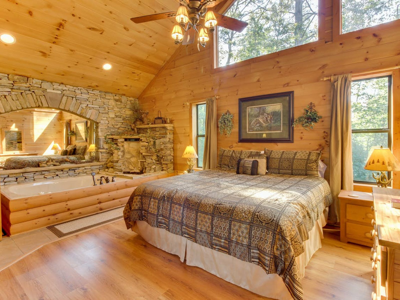 master bedroom with stone-framed jacuzzi complete with waterfall feature