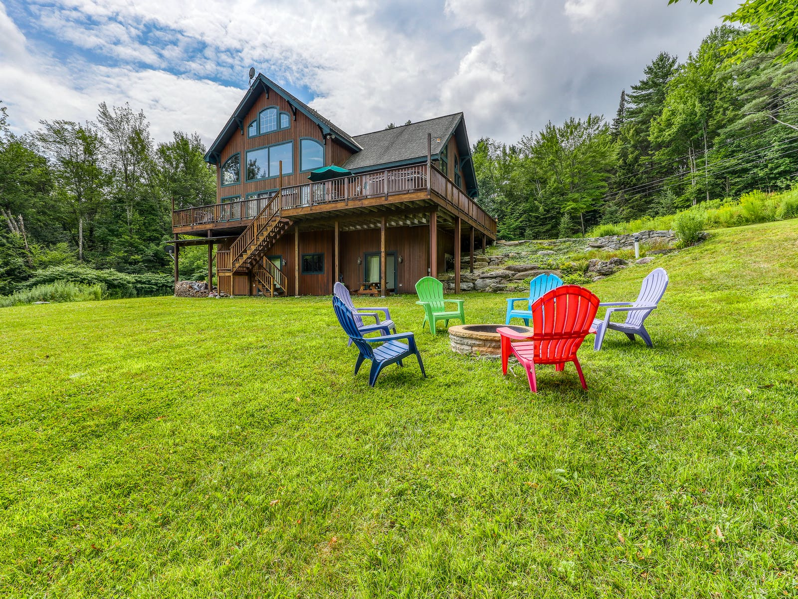 two-story vacation rental with large yard and firepit in Ludlow, VT