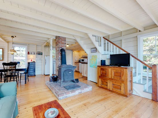 Boothbay Harbor, ME vacation home with wood-burning fireplace and wood paneled ceilings
