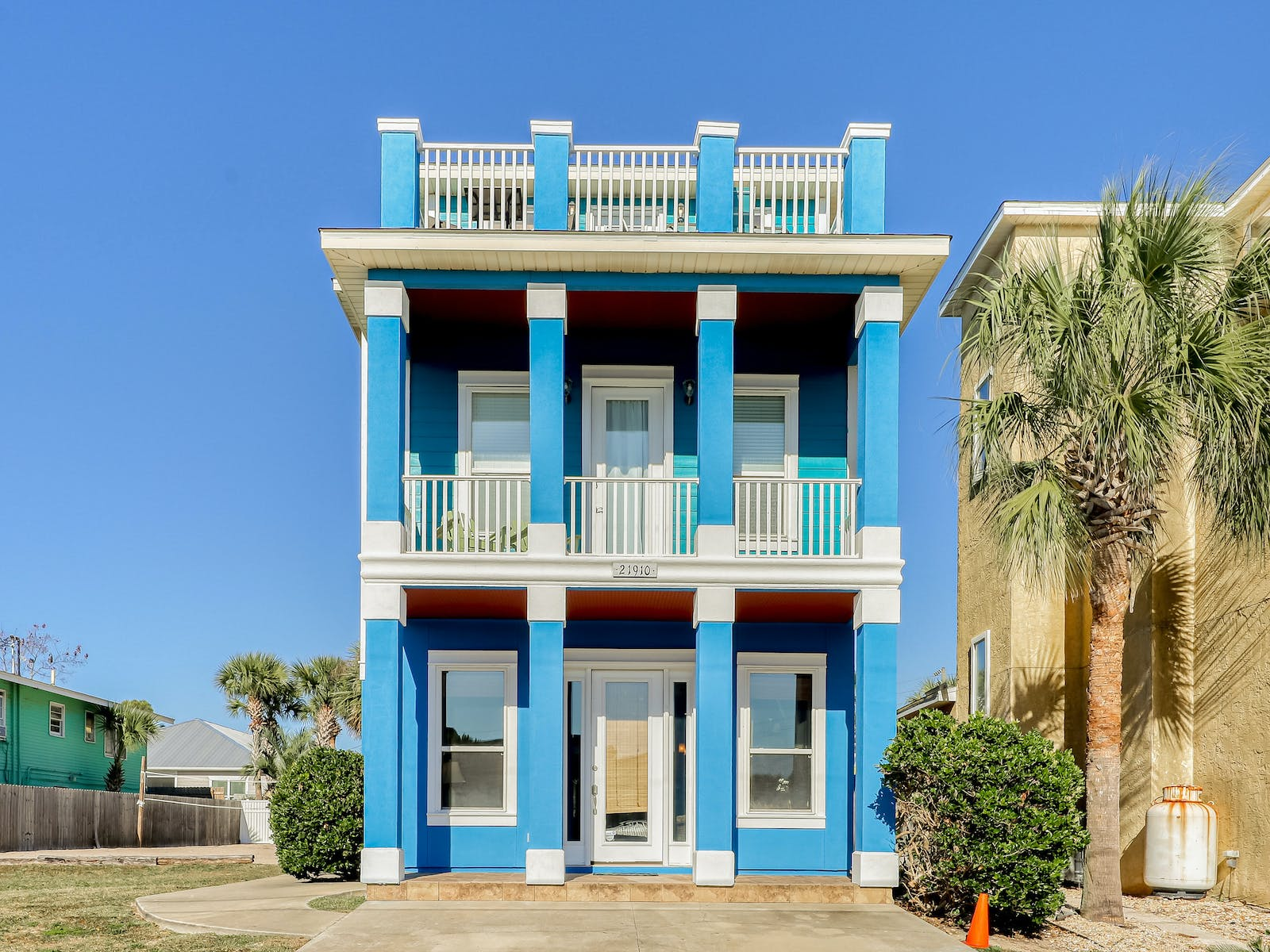 three story blue vacation home in pcb, fl