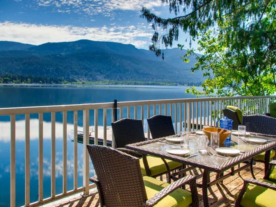 outdoor dining table overlooking Christina Lake, BC