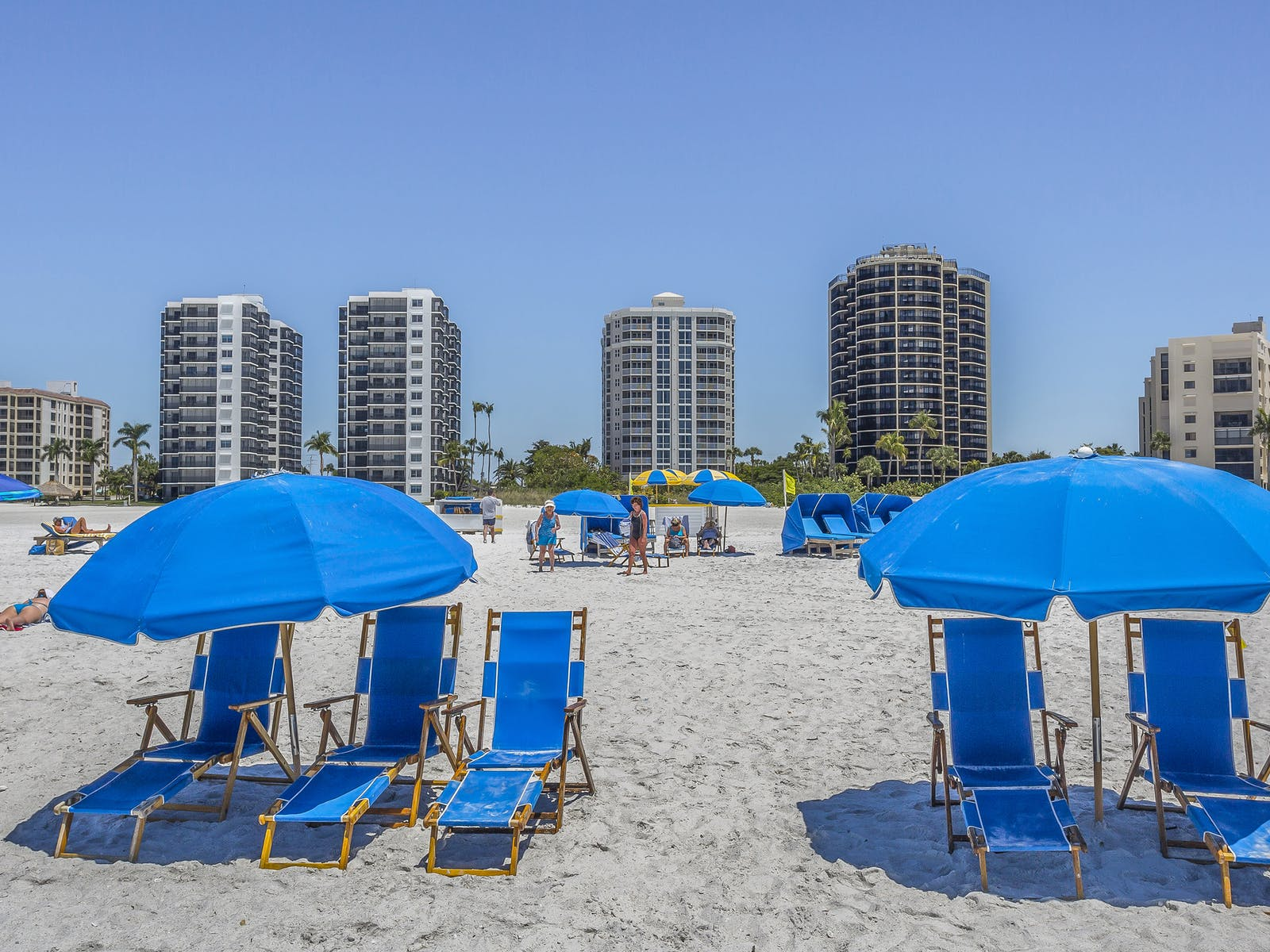 beach in sanibel, florida with large condo buildings in the background